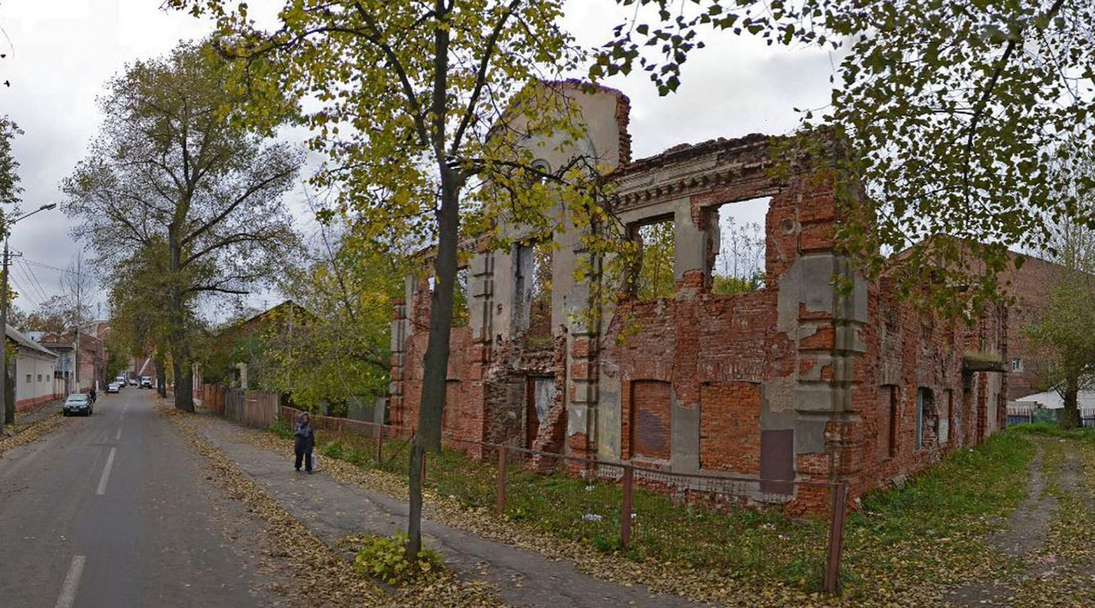 A woman walks past the ruins of the Great Lubavitch Synagogue in Vitebsk, Belarus. (Courtesy of the Municipality of Vitebsk)